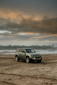 Free photo of Pangea Green Metallic Land Rover Defender Offroad