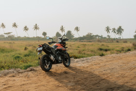 Free photo of KTM 390 Adventure ADV Motorcycle parked on dirt road
