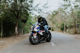 Free photo of Man on BMW Motorrad S 1000 RR in Middle of Road