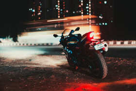 Free photo of Rear view of Parked Blue Suzuki GSXR Motorcycle With Red Tail lights