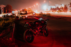 Free photo of Kawasaki H2 parked on road in light city light